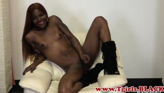Tattooed ebony strips down during TS debut